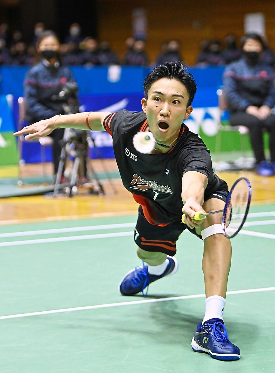 Still fiery: Kento Momota in action against compatriot Kanta Tsuneyama in the final of the All Japan National Championships in Tokyo. — AFP
