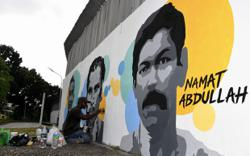 Mural artist pays tribute to Penang football legends at City Stadium