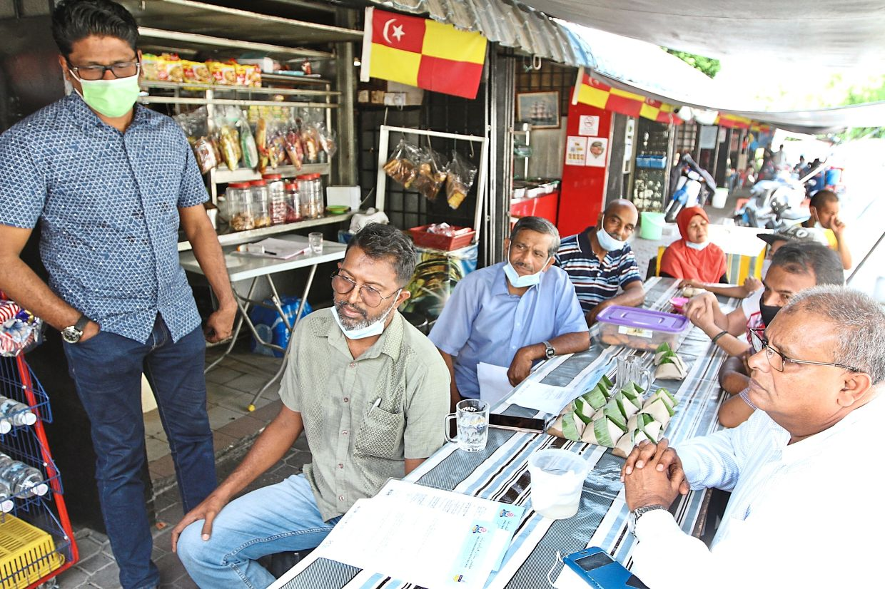 Stall operators along Jalan 13/4 in Petaling Jaya are reluctant to relocate due to the economic uncertainties brought on by Covid-19. — Filepic