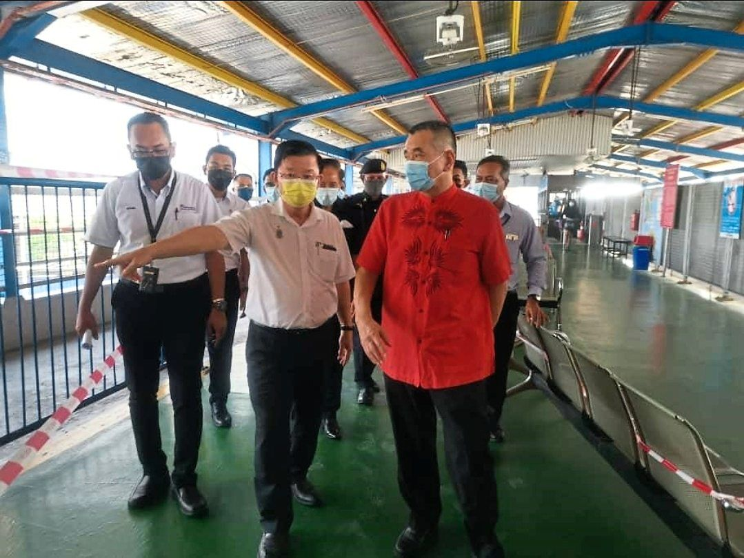 Tan (in red) and Chow (middle) checking out the fast boat ferry service at the Sultan Abdul Halim ferry terminal in Butterworth.