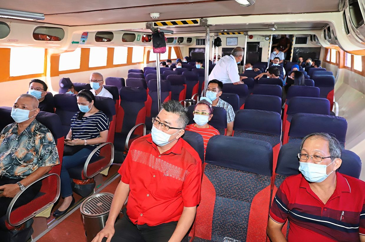 Passengers trying out the new fast boat ferry from the terminal in Butterworth.