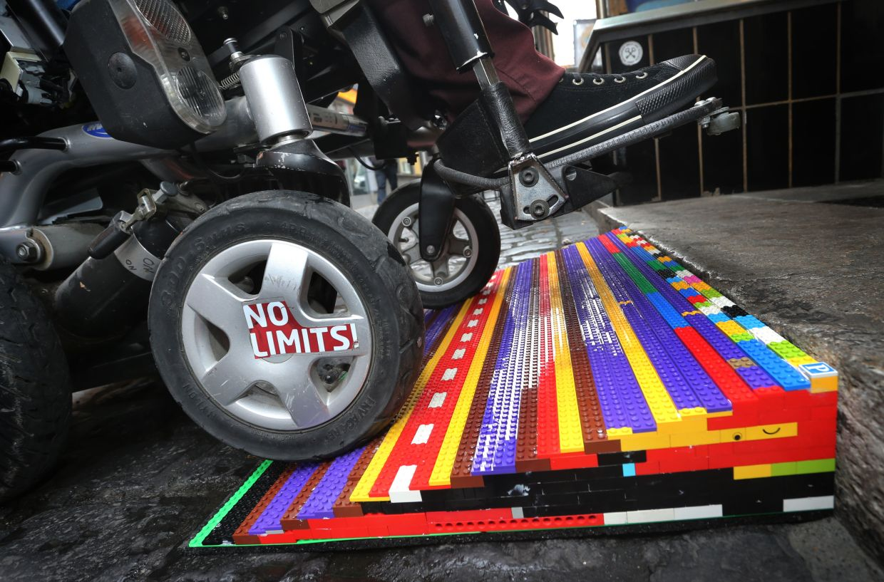 Kerbs and flights of steps are part of city life, but they can be huge obstacles to wheelchair users. Activists are trying to change the urban landscape, and mindsets – with the help of Lego bricks.