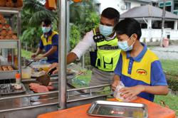 PJ police donate new mobile phone to burger stall operator after theft