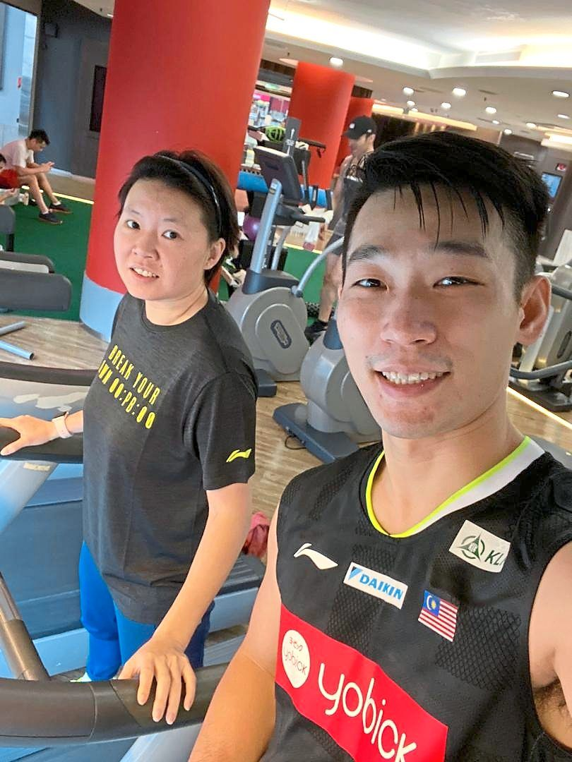 Hard taskmaster: There's no break for Chan Peng Soon even on New Year's Day as he hits the gym under the close watch of coach Chin Eei Hui (left) yesterday.