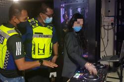 Karaoke joint with 'sexy DJs' raided