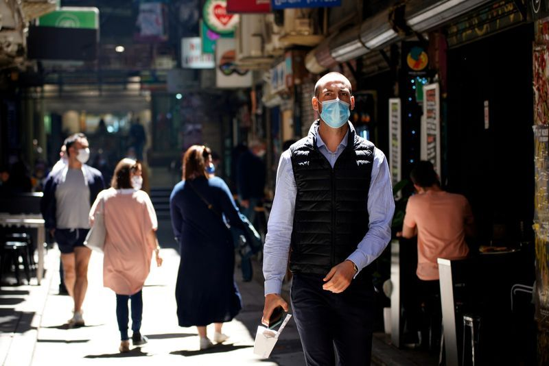 FILE PHOTO People walk down a city laneway after coronavirus disease COVID-19 restrictions were eased for the state of Victoria in Melbourne Australia October 28 2020. REUTERSSandra Sanders