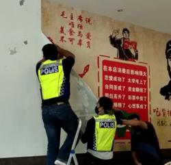 Cops raid restaurant decorated with Communism-inspired wallpaper