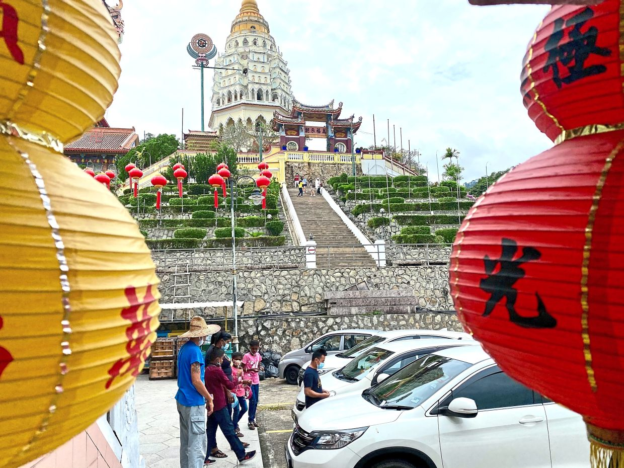 Visitors parking their cars at the foot of Kek Lok Si Temple.