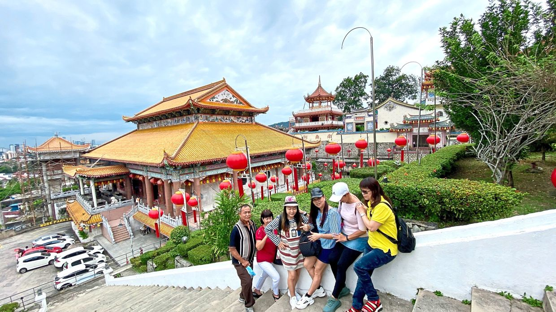 Visitors enjoying the scenic view at Kek Lok Si Temple.