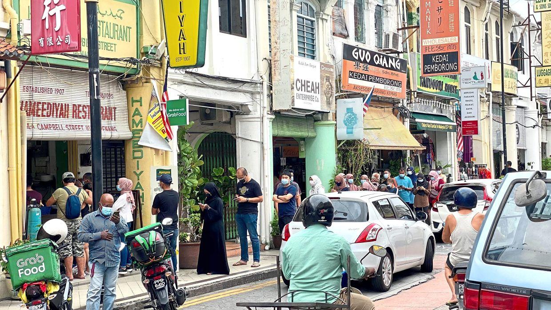 People making a beeline for their fix of nasi kandar at Hameediyah Restaurant in George Town.