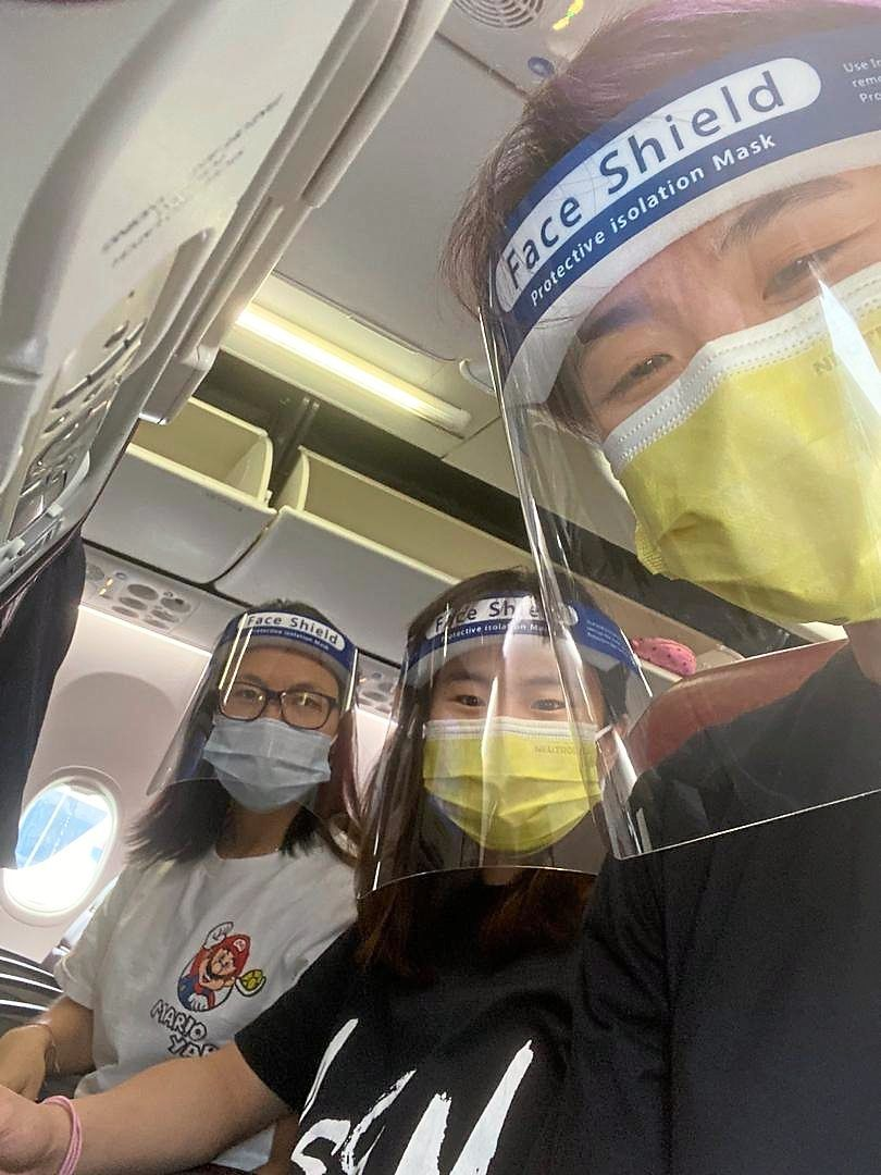 No hassle: Pearly Tan (centre), Yap Cheng Wen (left) and Vivian Hoo in good spirits on board the flight.