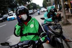 Gojek, Tokopedia in $18 billion merger talks for Indonesia's biggest deal