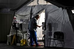 Ambulances put on alert as Los Angeles hospitals swamped by COVID-19 patients