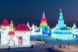 Frozen towers and palaces stun visitors at China's Harbin ice festival