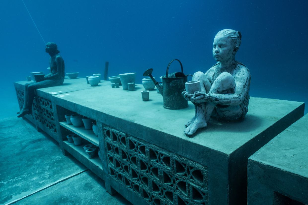 The Museum of Underwater Art (MOUA) features a series of installations by underwater sculptor Jason deCaires Taylor. - Jason deCaires Taylor