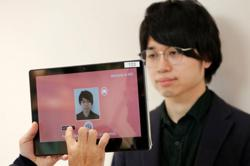 Masks no obstacle for Japan's NEC facial recognition system