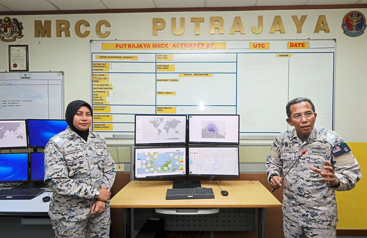 Admiral Zubil (right) and Commander Suzanna at the Malaysian Maritime Enforcement Agency's rescue centre headquarters in Putrajaya. — Photos: SAMUEL ONG/The Star