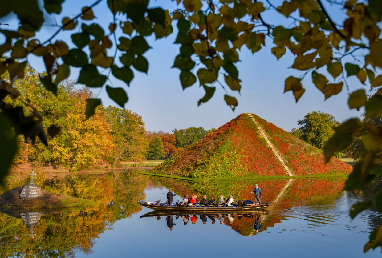 The lake pyramids at Fuerst Pueckler Park in eastern Germany are covered in wild vines. — PATRICK PLEUL/dpa
