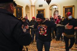 Mob at US Capitol encouraged by online conspiracy theories