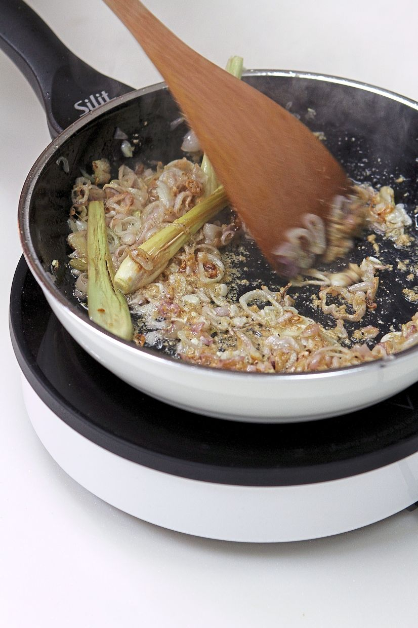 Stir the lemongrass and onions until the onions turn translucent.