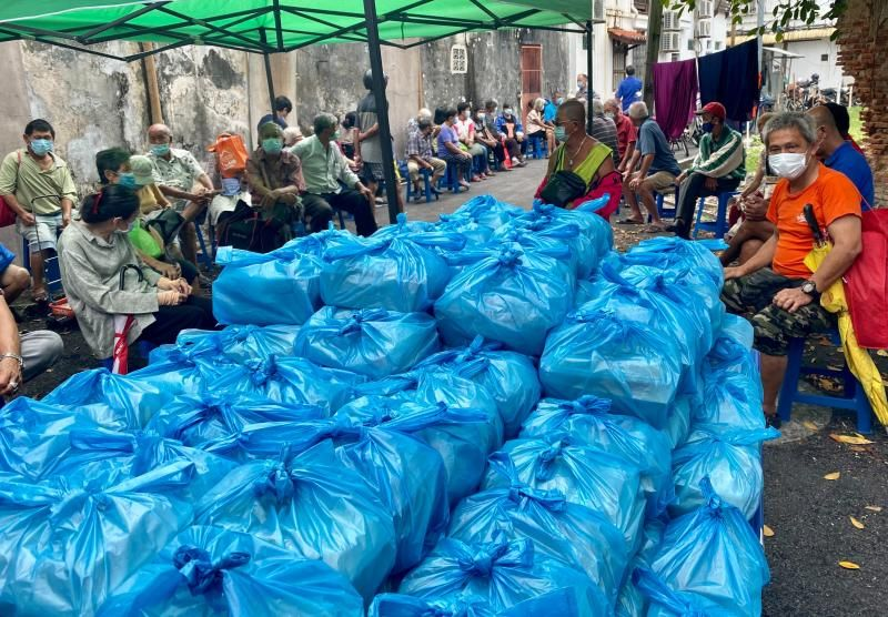 The food packets bundled in plastic bags meant for residents in the B40 group.