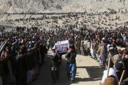 Slain Pakistani miners buried after protest