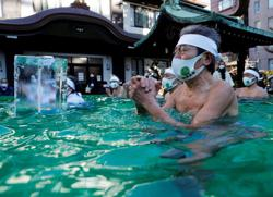 Japanese pray for end to pandemic in annual ice bath ritual at Tokyo shrine