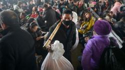 Coronavirus: Chinese urged not to make 'unnecessary' trips home for Lunar New Year