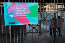 Mass vaccination sites open in New York City as COVID-19 batters U.S.