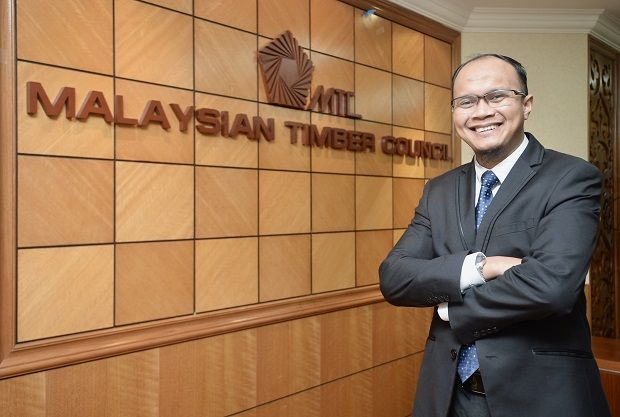 MTC chief executive officer Muhtar Suhaili poses against the MTC logo.