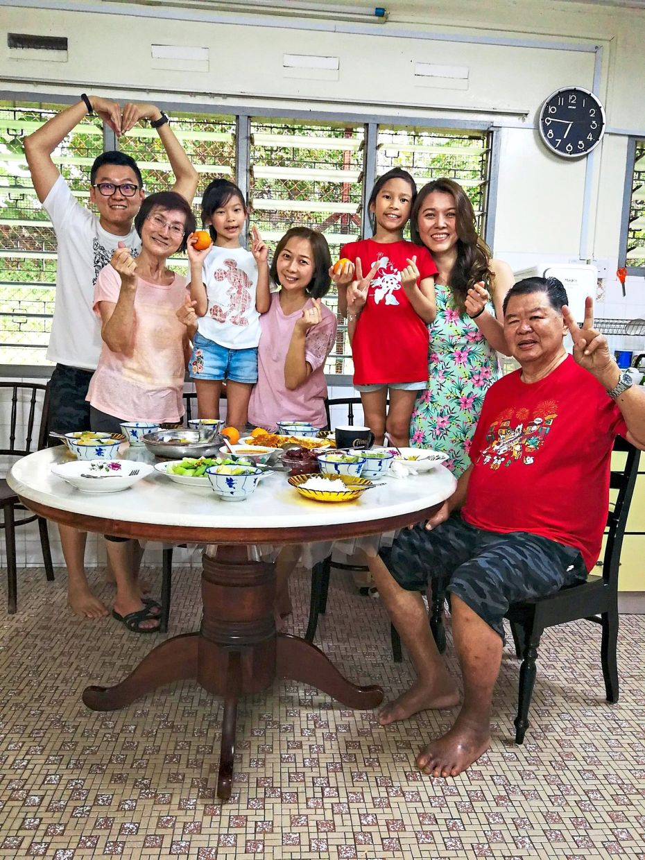 Chew (second from right) with her family in Taiping, Perak, during last year's CNY. Photo: Kathy Chew