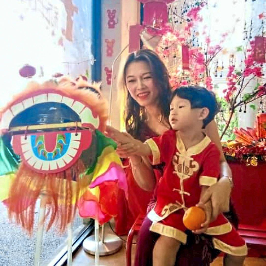Chew, who runs a daycare centre (pictured with one of her students during CNY 2020) always goes back to her hometown every CNY. Photo: Kathy Chew
