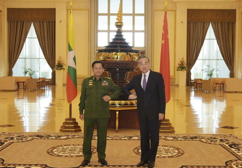 Myanmar's Army Commander Senior Gen. Min Aung Hlaing (left) and Chinese Foreign Minister Wang Yi pose for a photo during their meeting in Naypyitaw, Myanmar, Tuesday, Jan. 12, 2021. - AP