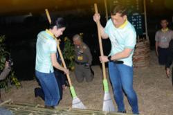 Palace photos show Thai king, royal consort visiting prisons, sweeping floors
