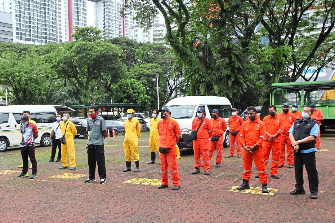 The teams from DBKL and Kuala Lumpur Fire and Rescue Department being briefed before a sanitisation exercise in Kuala Lumpur.