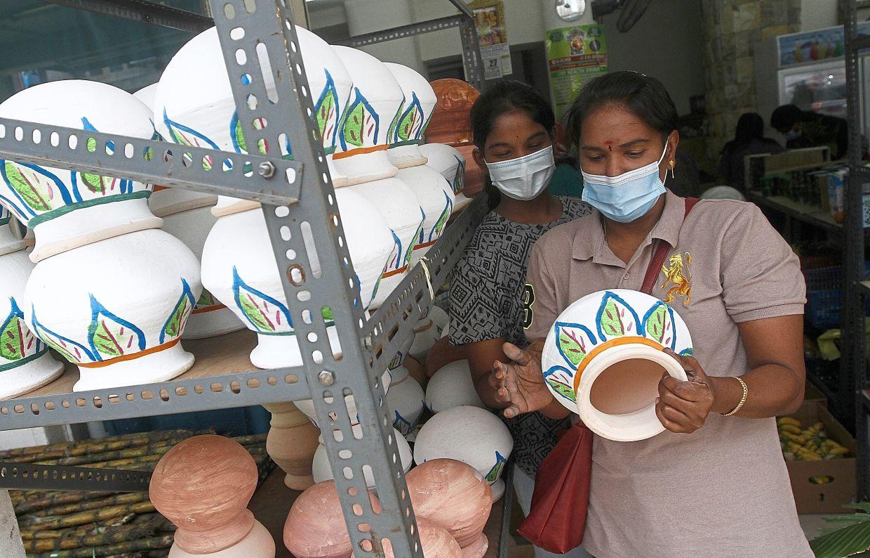 P. Valli (left) and her daughter C. Mahalakshmi choosing a  claypot at a shop.
