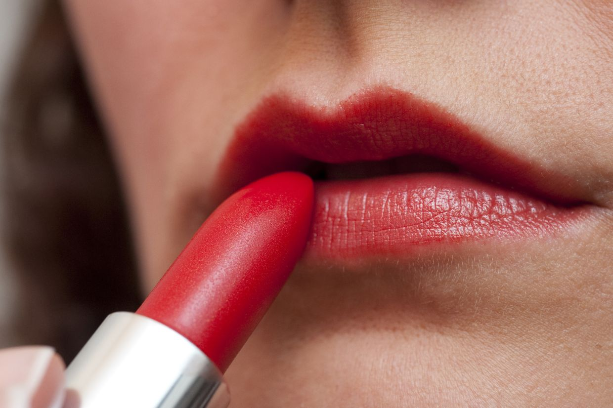 If you're using red lipstick at work, make-up experts suggest you don't also emphasise the eyes or cheeks. Photo: Andrea Warnecke/dpa