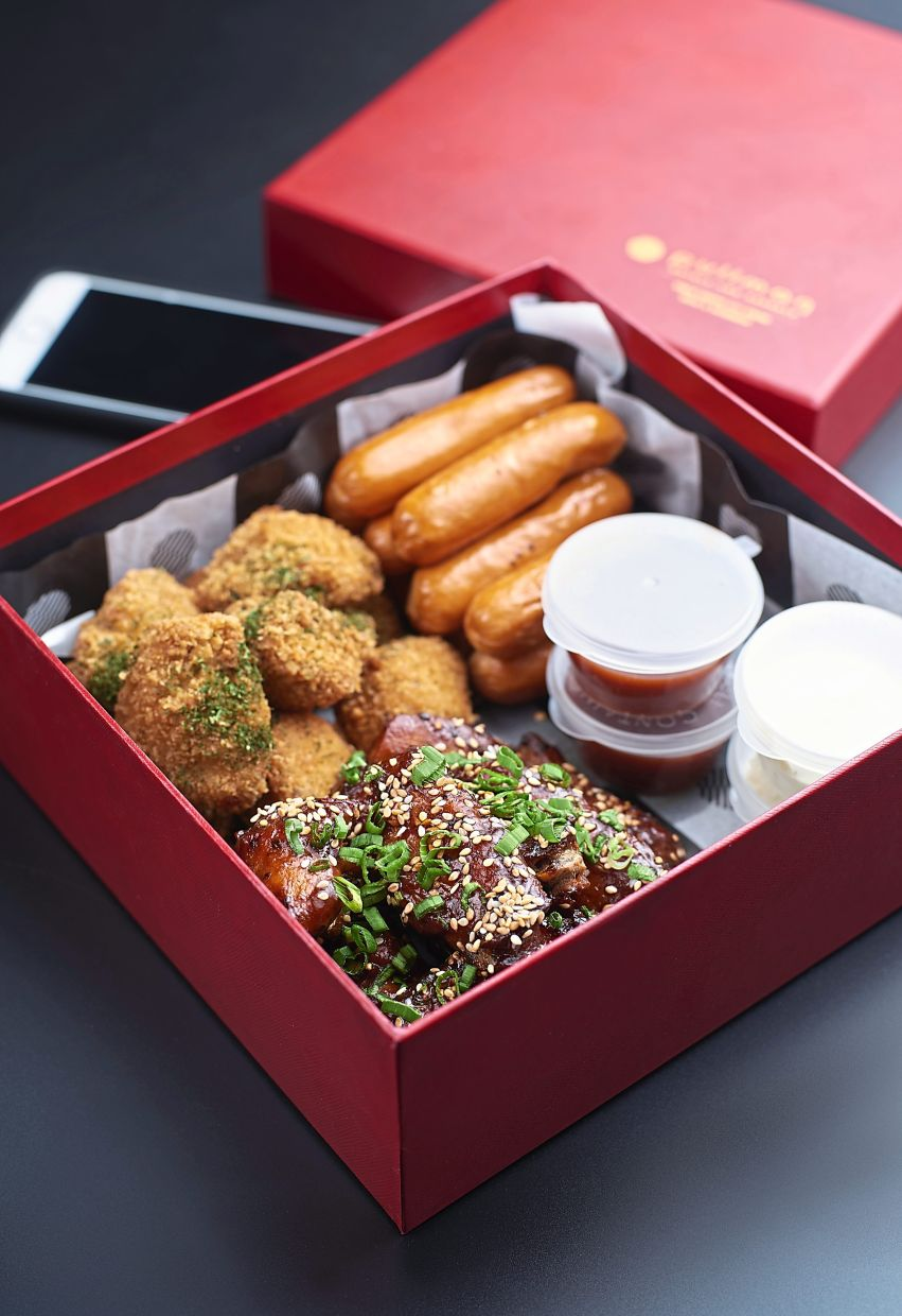 The Chicken Snack Box features sesame barbecued chicken wings, handmade chicken nuggets and chicken sausage.