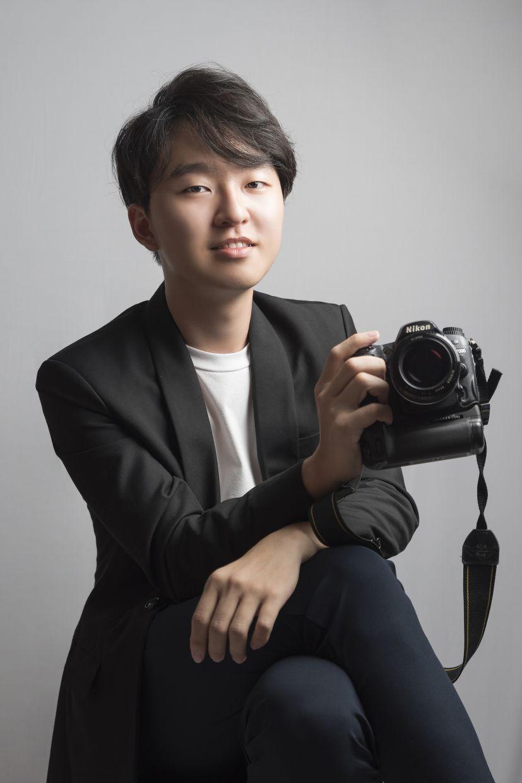 Mentored by Zamri, Tang runs his own business, JL Photography.