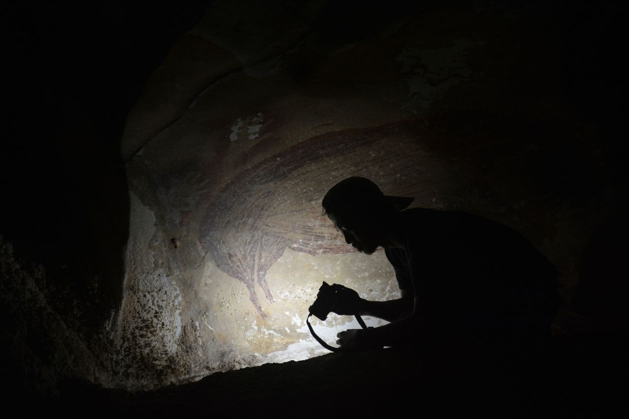 The team believes the artwork was made by Homo sapiens, as opposed to now extinct human species like Denisovans, but cannot say this for certain. Photo: AFP