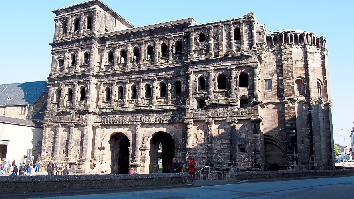 Porta Nigra in Trier, Germany is a large Roman city gate made from blocks of local sandstone fastened in place with iron clamps.