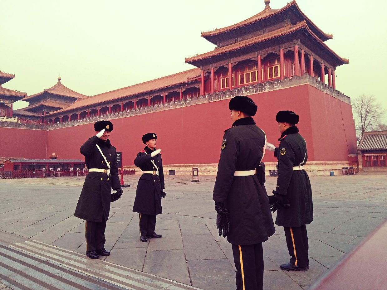 Not every picture needs to be edited. This shot of the guards at Beijing's Forbidden City taken a few years ago on a very hazy afternoon looks edited but isn't.