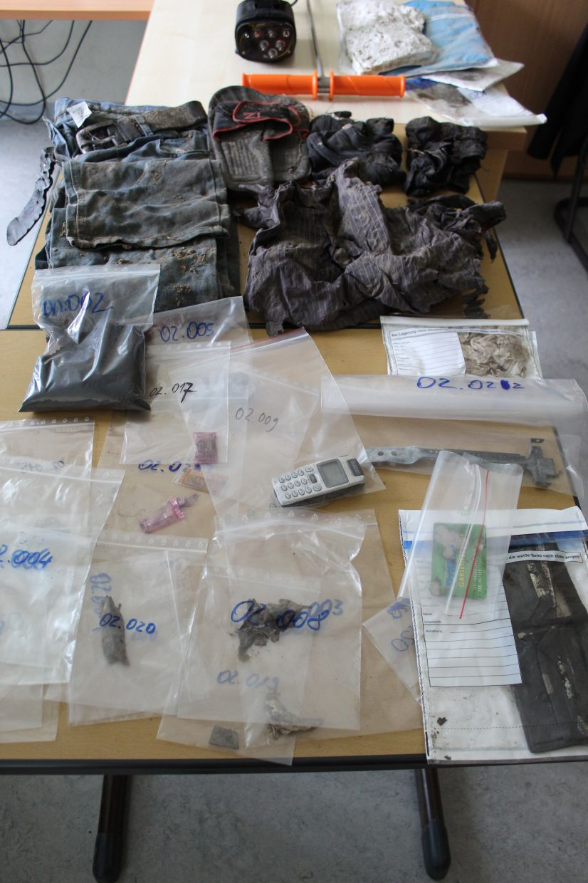 Items found at a crime scene during a training exercise are displayed on a table in Germany.