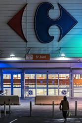 Canada's Couche-Tard in talks to buy French grocer Carrefour