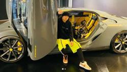Jay Chou poses with daughter in front of RM6.8mil super sports car