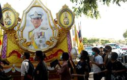 Thai police arrest student after king's portraits defaced