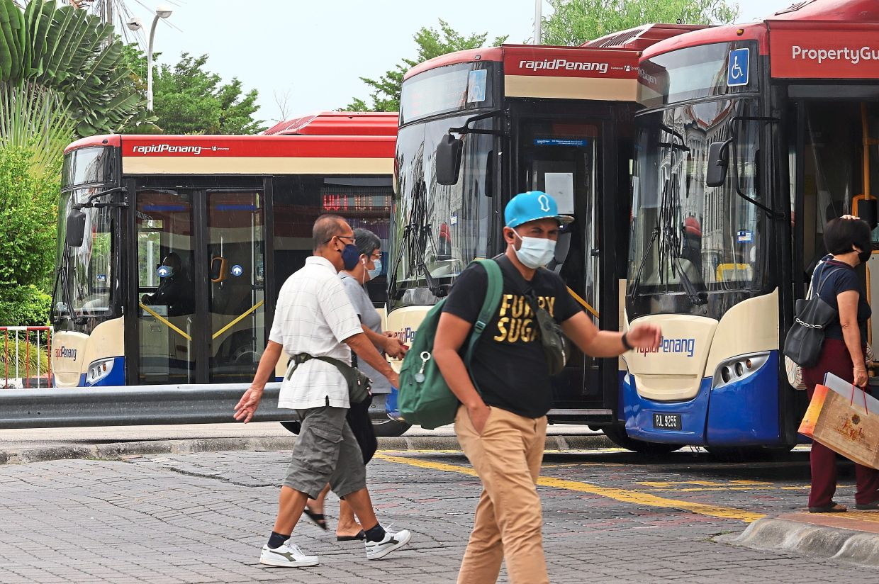 Commuters heading  for their buses  at the terminal.