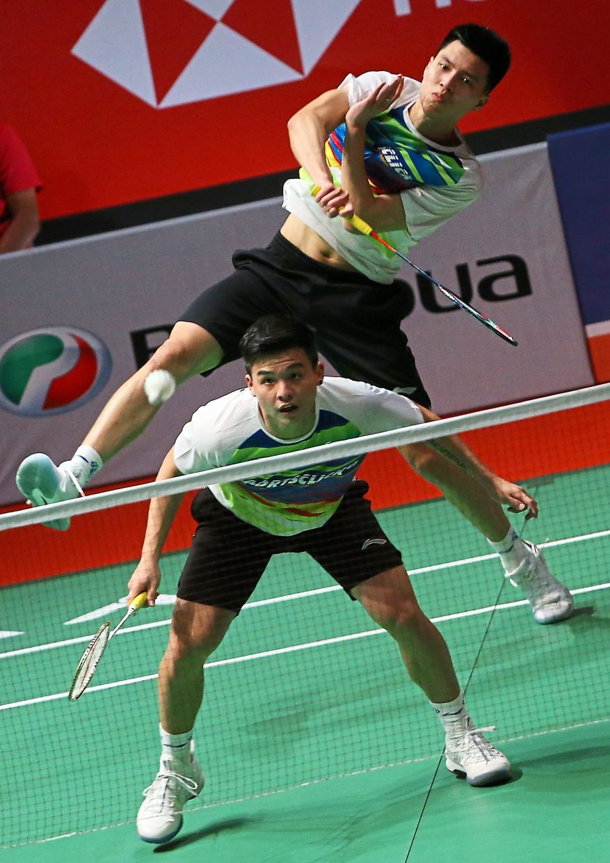 Smooth sailing: Ong Yew Sin and Teo Ee Yi took only 22 minutes to beat Philip Chew-Ryan Chew of the United States 21-12,21-7.