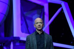 Bezos' Blue Origin aims to fly first space passengers by April: CNBC