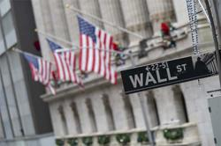 Wall St ends lower as investors weighed stimulus hopes and bleak jobs data